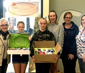 École Publique l'Escalade donates 1600 PICC Covers to the Lady Dunn  Health Centre!